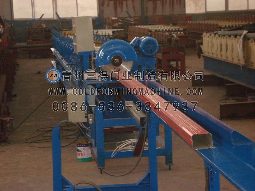 máquina de formação de rolos de saída