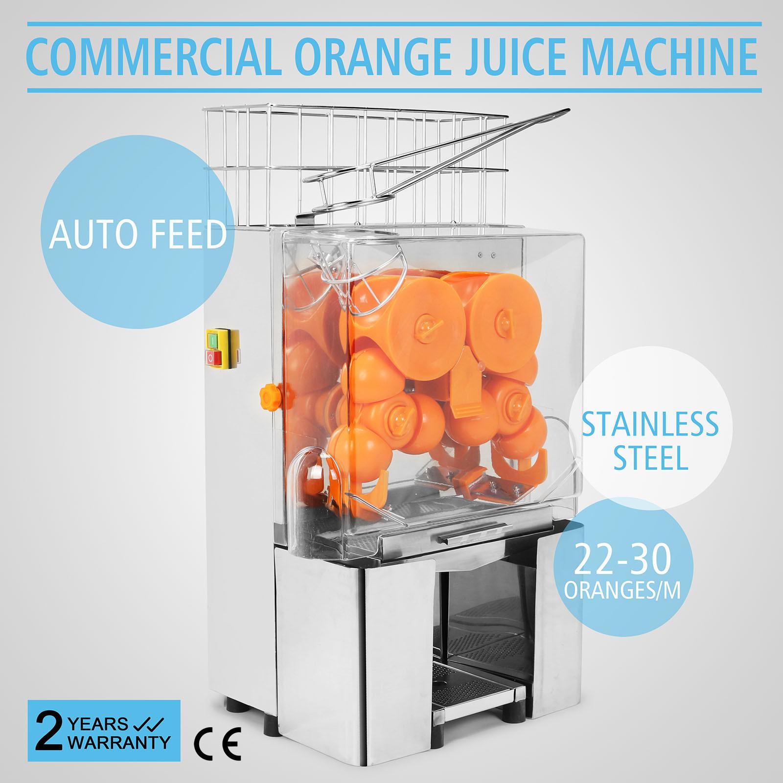 Foto de El jugo de naranja eléctrico comercial exprimidor