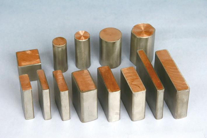 Compuesto de cobre revestidos de titanio