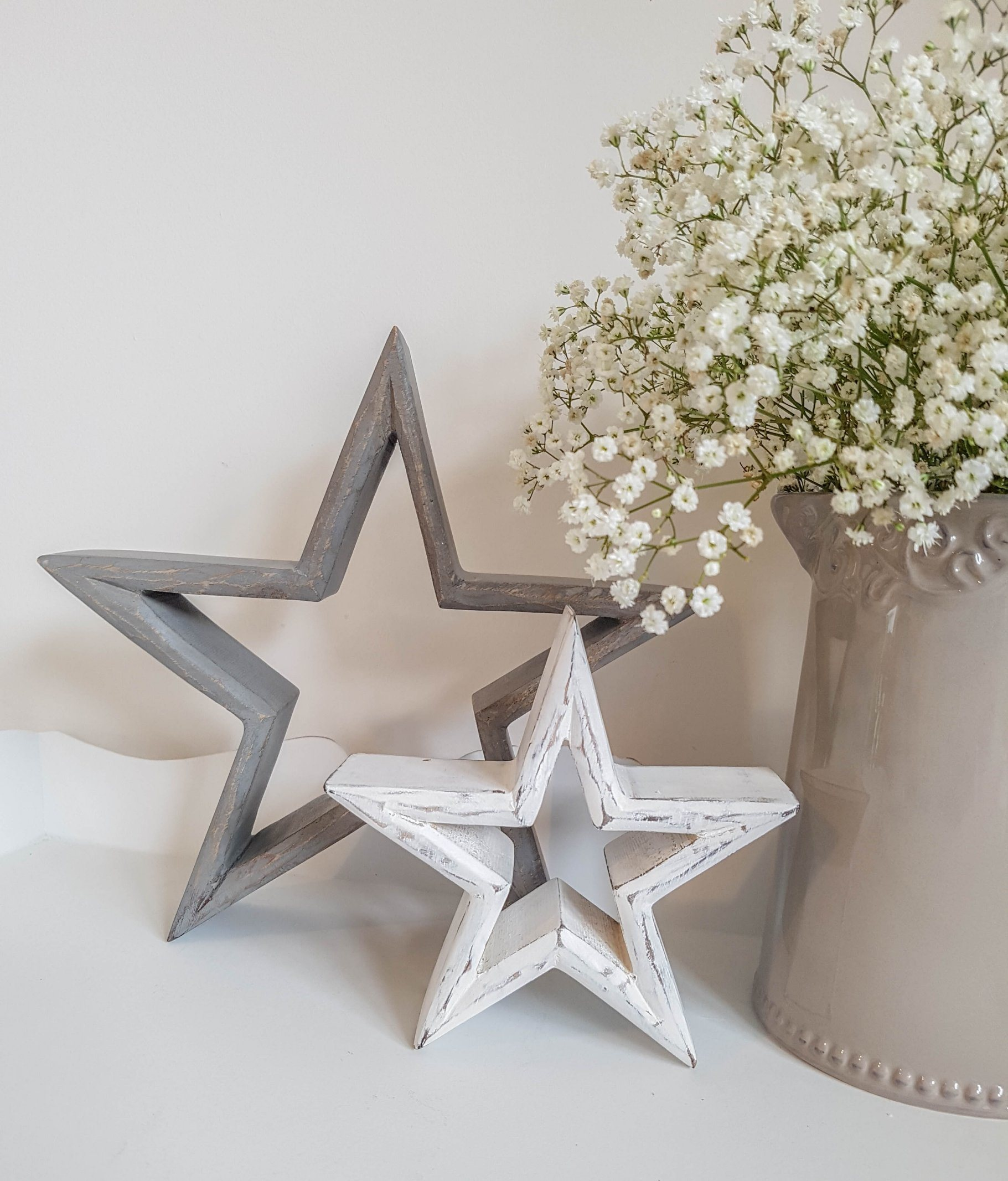 ホーム装飾のための一定の灰色および白い苦しめられた木の星
