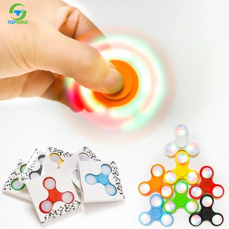 Venta caliente condujo Dazzle Color Light Fidget mano Spinner