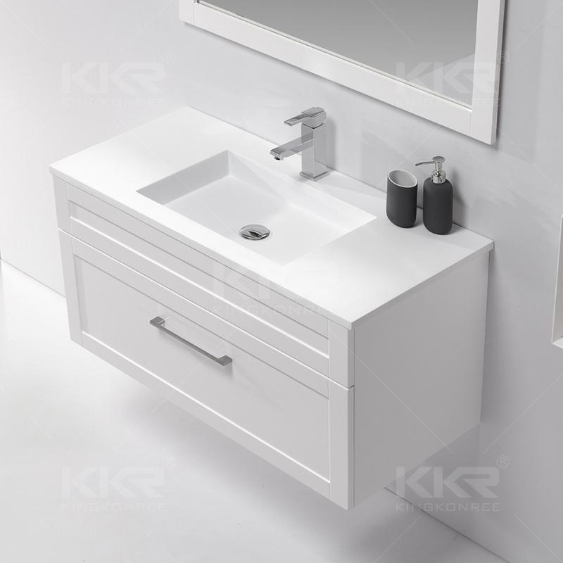 Foto de el corian muebles lavamanos con armario de madera for Lavamanos empotrados