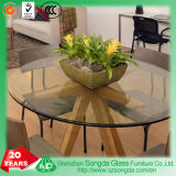 Beveled Glass Table Top on Modern Table Base Creating Space