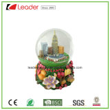 Polyresin Gift Customized Snow Globe with Flowers& Building for Souvenir Gift and Home Decoration