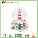 Customized Polyresin Craft Snow Globe with Light House Water Globe for Home Decoration and Souvenir