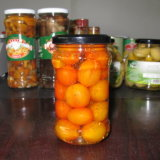 Unpeeled Cherry Tomato Marinated in Glass Jar