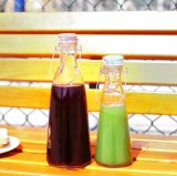 Hot Sale Cheap Clear Glass Juice/Water Bottle with Ceramic Lid for Drinking