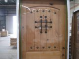 Speakeasy and Decorative Clavos and Grill Wrought Iron Exterior Door