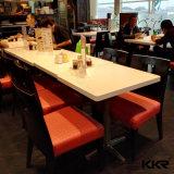 ダイニングテーブルの白い固体表面の長く4つのSeatersのダイニングテーブル