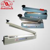 Máquina da selagem da mão com plataforma da película do cortador e do rolo para o selo e o corte dos sacos da embalagem