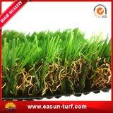 Erba artificiale delle piante per il giardino e la casa di paesaggio