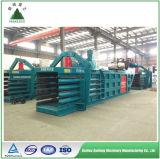 Papier de rebut et machine hydrauliques horizontaux de presse de plastique