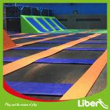 Прямоугольный большой крытый парк Trampolin скачки с олимпийской циновкой Trampoline