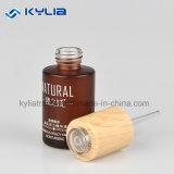 bouteille en verre ambre d'huile essentielle de compte-gouttes du chapeau 30ml en bois