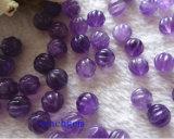 宝石類の部分自然な紫色の切り分けられたビード