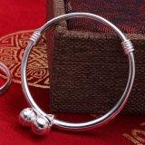 Doppi braccialetti e calzini dell'argento della Bell dei bambini S999