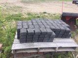 Il granito grigio di pietra naturale copre di tegoli i lastricatori della strada privata per la pavimentazione