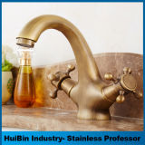 O cristal de bronze dourado luxuoso do Faucet da bacia do estilo de Europa segura a torneira de misturador do dissipador da vaidade