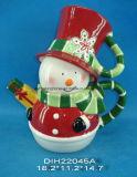 Teiera di ceramica dipinta a mano del pupazzo di neve con l'insieme della tazza