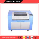 O laser acrílico/do CO2 plástico/madeira/600*400 gravam e a máquina de estaca Pedk-6040