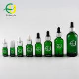 De vidrio verde botella con gotero