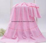 Les serviettes de bain en coton bouclé, rose/bleu/jaune