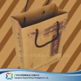 Papel Kraft marrón Embalaje Bolsa de transporte para ir de compras// Regalo ropa (XC-bgg-005).
