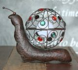 Arte del caracol del metal con la decoración ligera solar del jardín