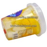 Enchimento do copo da polpa da fruta e máquina da selagem