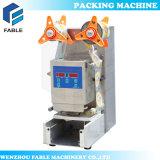 Copo de sumo de leite de plástico manual da máquina de embalagem (FB480)
