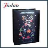 La insignia brillante del negro de la laminación modifica la bolsa de papel para requisitos particulares impresa la Navidad