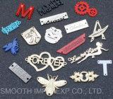Contrassegno su ordinazione dei vestiti del metallo di modo 3D di marchio dell'indumento all'ingrosso di marca
