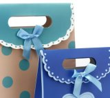 Gekopierter Geschenk-Paket-Beutel mit magischem Band-Druckknopf