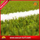Césped artificial de la alfombra sintetizada de la hierba para el césped falso de la hierba de los hogares