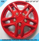 Пластиковый колпак колеса автомобиля красного цвета