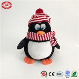 Pieds heureux de pingouin de danse de la CE d'enfants de jouet mou de peluche