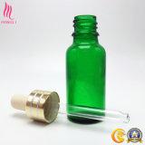 Botella de aceite esencial de vidrio con tapa de aluminio y la pipeta