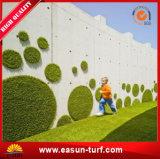 합성 잔디밭 뗏장을 정원사 노릇을 하는 도매 정원