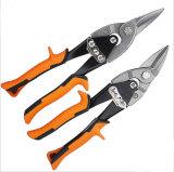 Le forbici del ferro rosse e la doppia aeronautica nera della maniglia di colore tagliano gli Snips dello stagno
