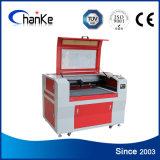 Mini precio de acrílico de madera de la maquinaria del grabado del laser del papel