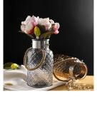 Vaso di vetro europeo della campagna con la corda della maniglia