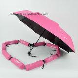 ثلاثة يطوي سوداء طلية مظلة مع طباعة يبدى عندما مبلّلة