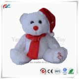 귀여운 크리스마스 Xmas 모자와 스카프를 가진 앉는 견면 벨벳 곰