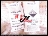 Pérolas de soda cáustica de alta pureza. Grânulos de hidróxido de sódio