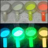 Un'incandescenza di 12 colori nella polvere fluorescente luminosa scura del pigmento