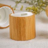 Capsule cosmétique avec le couvercle en bois en bambou de chapeau