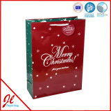 Bolsos brillantes del regalo de la Navidad del papel revestido del pequeño reno verde para el partido