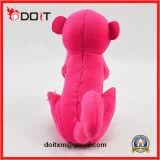 赤いプラシ天のおもちゃ猿によって詰められる猿のプラシ天のおもちゃ