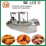Galinha comercial e peixes do restaurante do equipamento que fritam a máquina