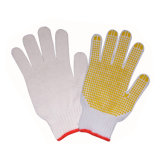 Doublure en coton blanc des gants de caoutchouc de la main en pointillés